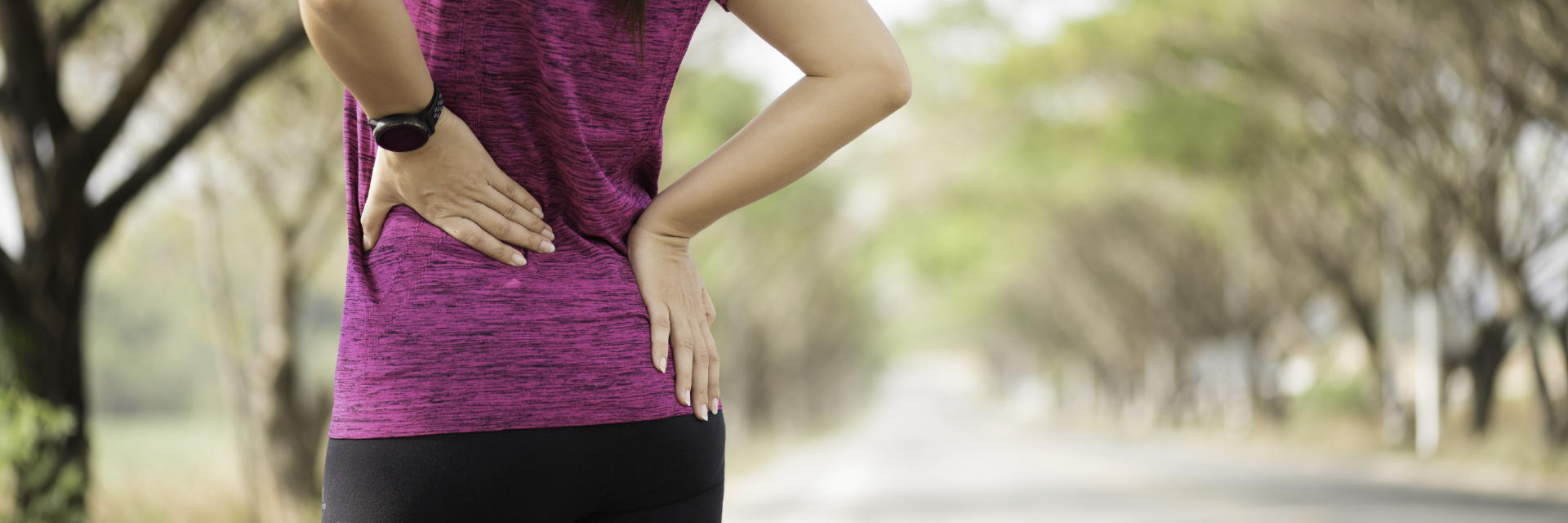 A runner woman with pain in lower back and hip area.