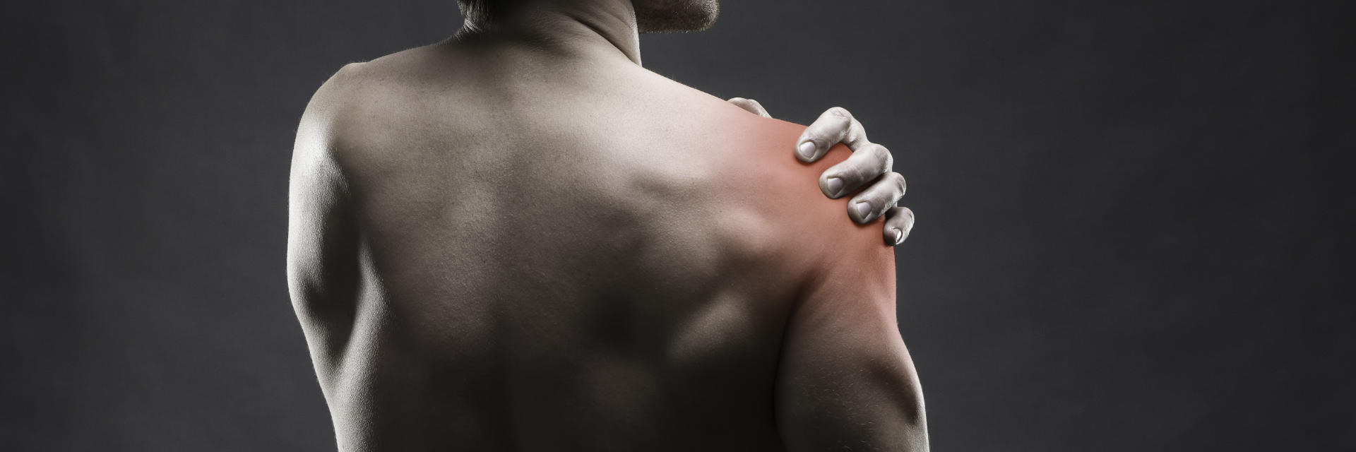 A man with suffering from shoulder tendonitis.